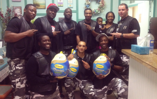 Oahu Ruff Ryders donating Turkeys to the River of Life Mission in Honolulu